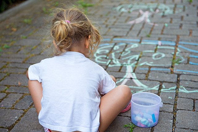 child is painting the street